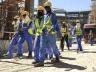 construction workers leave a work site in Qatar's capital Doha.