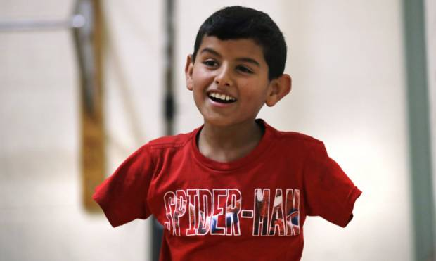 Armless Syrian boy thrives in US