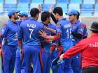 Mohammed Nabi of Afghanistan celebrates with his teammates after removing Zane Green of Namibia during the Desert T20 Tournament at Dubai Cricket Stadium.