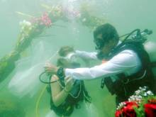 A wedding takes place beneath the waves