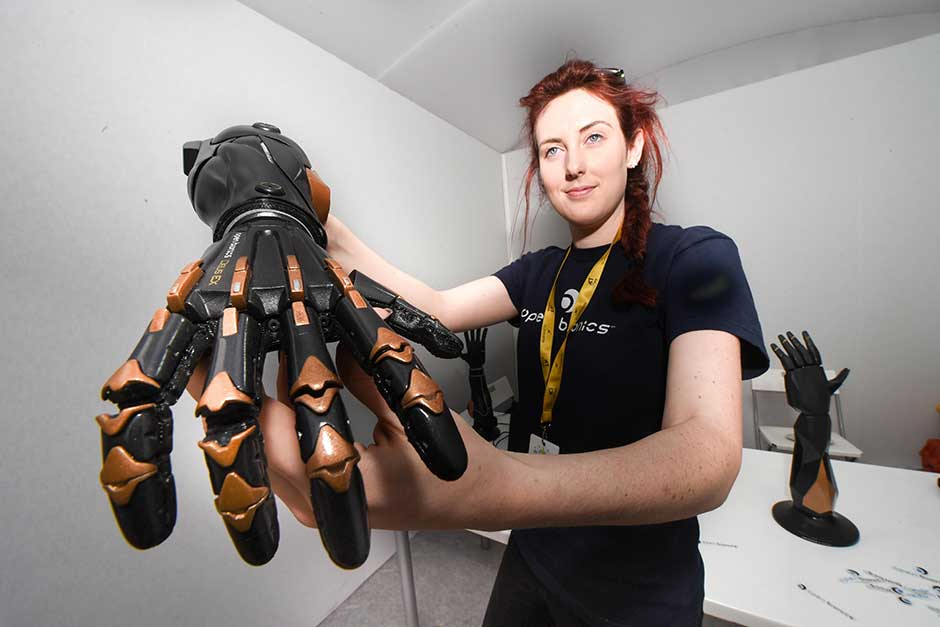 Sam Payne from Open Bionics display a robotic hand.