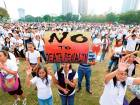 Thousands of Roman Catholics sing religious songs following a 'Walk for Life' march around Manila's Rizal Park to oppose the killings of drug users and drug pushers in the so-called war on drugs by President Rodrigo Duterte, at dawn on Saturday.