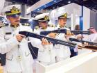 UAE Navy officers check out the gun from Taurus of Brazil at the latter's pavilion.