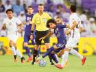 Omar Abdulrahman of Al Ain tries to penetrate the defenses of El Jaish (Qat) during semi finals of the AFC Champions League at the Hazza Bin Zayed Stadium in Al Ain.