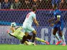 Leicester City's Kasper Schmeichel makes a save during the Champions League Round of 16 First Leg match against Sevilla at the Ramon Sanchez Pizjuan Stadium.