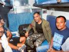 Jharkhand cricket team captain MS Dhoni with his team-mates on board a train for Kolkata, at Hatia Station in Ranchi. The team left for Kolkata to play the opening match of Vijay Hazare Trophy against Karnataka.