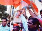 Shiv Sena activists celebrate results of the municipal elections in front of the party's office in Mumbai.