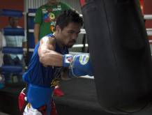 Pacquiao to fight Britain's Khan in April