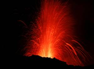 Mount Etna erupts, lights up Sicilian sky