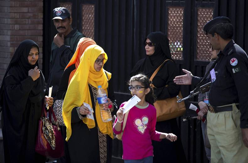 a-family-enters-in-the-gaddafi-stadium-under-tight-security-in-lahore-pakistan