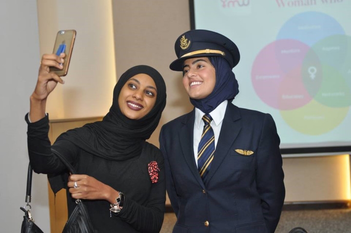 Alia Al Muhairi, an Airbus A380 Captain for Emirates, poses for a selfie with a visitor
