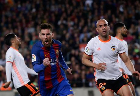Messi sizzles as Barca win Valencia thriller