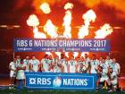 England players celebrate after winning the Six Nations Championship at the Aviva Stadium on Saturday. Ireland beat England 13-9 to deny the visitors a record-breaking Grand Slam victory.