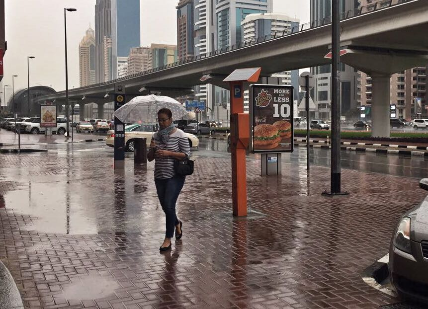 A scene in rain-soaked Dubai next to a metro station on Shaikh Zayed Road on Tuesday.