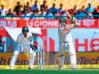 Australia's captain Steve Smith watches his shot as India's wicketkeeper Wriddhiman Saha looks on during the first day of the fourth and final Test in Dharamsala.