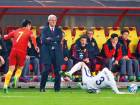 China coach Marcello Lippi (center) looks on during the Russia 2018 qualifying match againt South Korea on March 23.