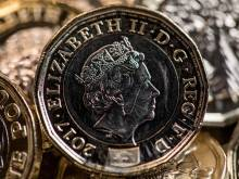 New British pound coin enters circulation