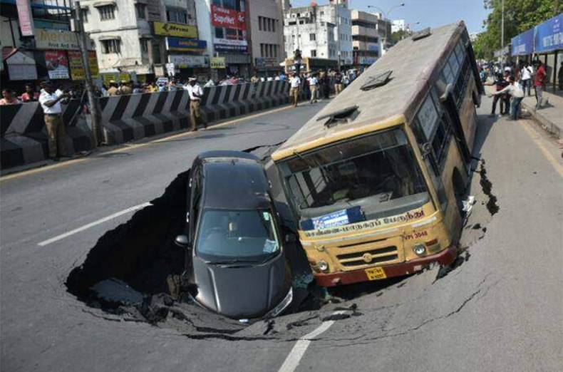 bus-car-plunge-into-big-crater-in-chennai-as-road-caves-in