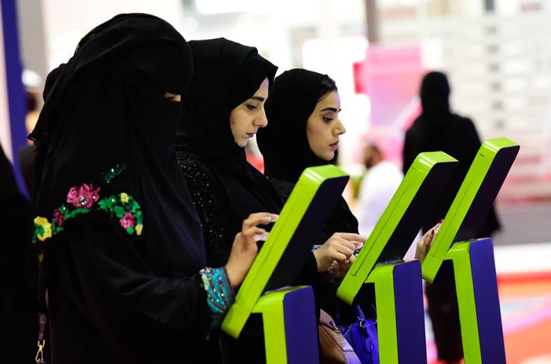 emirati-women-registering-themselves-at-an-etisalat-exhibit-during-the-careers-uae