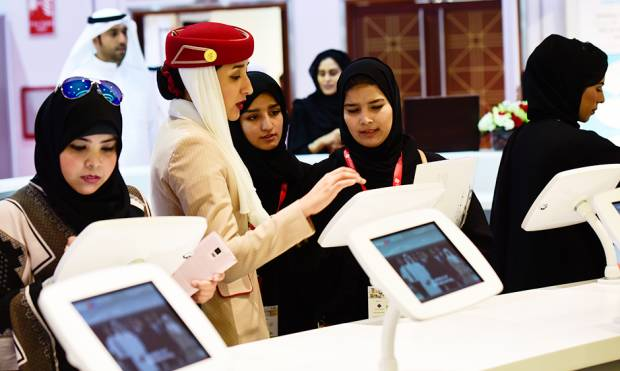 Emirati women registering themselves at the Emirates-Dnata exhibit