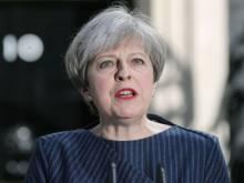 UK: May calls for snap election on June 8