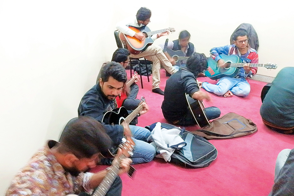 Students taking guitar