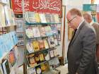 Egyptian Minister of Culture Helmy Al Namnam tours a book exhibition named after Sur Al Azbakia.