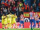 Villarreal's players celebrate after Roberto Soriano scored a last-gasp goal during the a La Liga match against Club Atletico de Madrid at the Vicente Calderon stadium in Madrid on Tuesday.