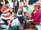 Children read the book at a pavilion during  the inauguration of the Abu Dhabi International Book Fair 2017 at ADNEC