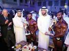 Amer Majid Jafar (right) and Mohammad Khalid Embaby of Egypt receive trophies from Shaikh Abdullah Bin Hamad Bin Saif Al Sharqi, Shaikh Hamad Bin Saleh Al Sharqi and Adel Fahim (left) at the end of the IFBB Diamond Cup in Fujairah.
