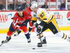 Sidney Crosby (87) of the Pittsburgh Penguins skates past Andre Burakovsky (65) of the Washington Capitals in Game One of the Eastern Conference Second Round in Washington.