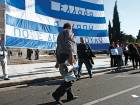 "Trade Unionists hold a giant Greek national flag reading ""Greece I Love You And I'm Not Selling You"" on Syntagma Square during a 24 hour general strike in Athens, Greece, on Thursday, Nov. 12, 2015."