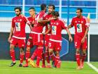 Hat-trick man Ali Mabkhout (No 7) is congratulated by his teammates after scoring one of his goals against Hatta on Saturday.