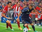 Real Madrid's forward Karim Benzema (right) vies with Atletico Madrid's defender Diego Godin on Wednesday.