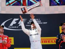 Hamilton cuts Vettel's lead in title fight