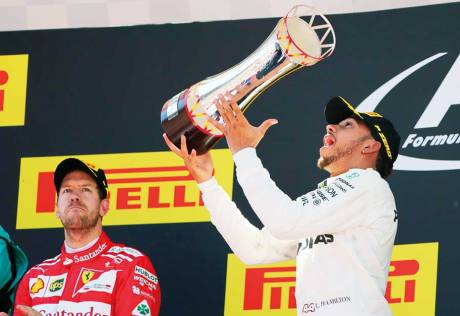 Hamilton puts in hard work to keep Vettel at bay