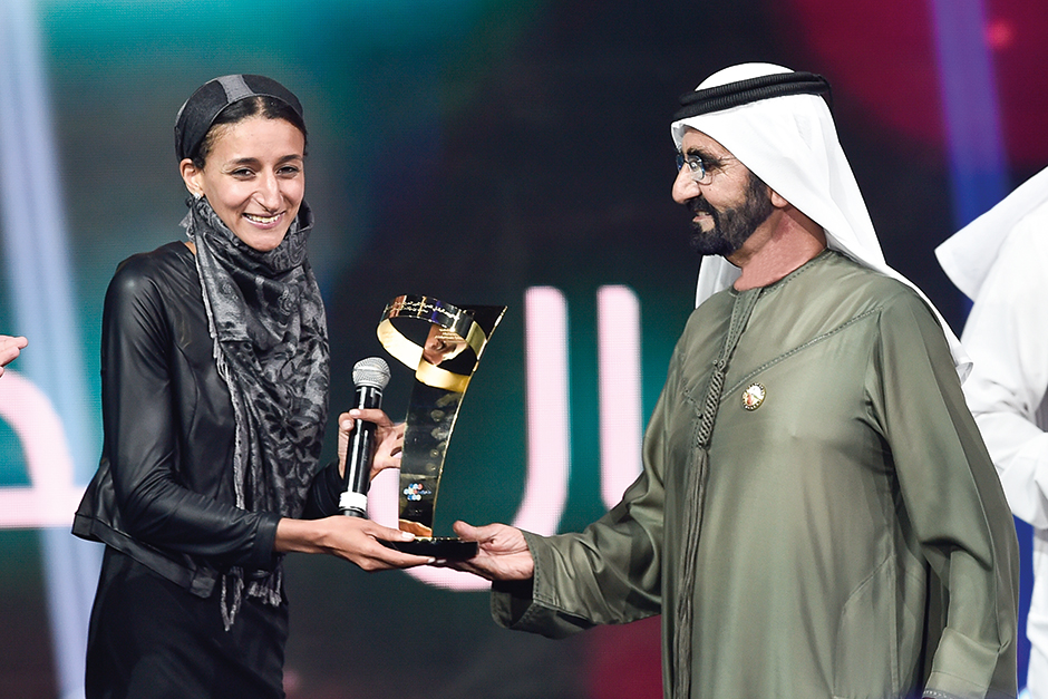Shaik Mohammad presents award to Nawal Al Soufi.