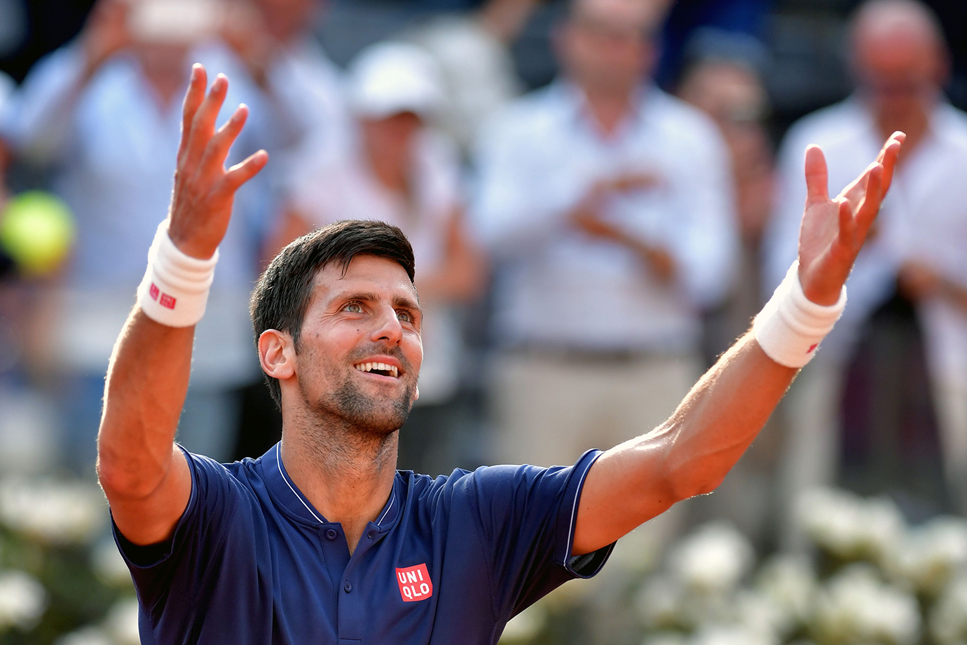 Novak Djokovic of Serbia celebrates after winning his third round match against Roberto Bautista dur