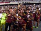 Al Wahda players with officials celebrate their victory  during the Peresident's Cup final.