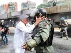 An opposition demonstrator argues with a riot policeman during a health care personnelmarch in Caracas on Monday. Doctors joined street protests against Maduro government.