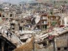 A car passes by damaged streets at the mountain resort town of Zabadani in the Damascus countryside, Syria.