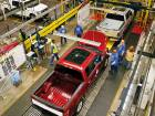 Ford's F-150 trucks on the production line at the Dearborn Truck Assembly facility in Michigan. One of the biggest challenges for Ford will come next year, when the F-150 truck will be challenged by GM's redesigned Chevrolet Silverado and GMC Sierra pickups.