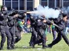 Riot police officers clash with demonstrators during a protest against Brazilian President Michel Temer and the latest corruption scandal to hit the country, in Brasilia, Brazil on Wednesday.