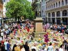 Balloons, flowers and messages of condolence are left for the victims of the Manchester Arena attack in central Manchester, Britain May 25, 2017.