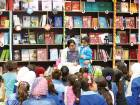 Shaikha Budoor reading a story titled Seller of Dreams to children during a reading session at the camp.