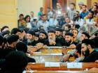 Clergymen and relatives of victims of Friday's terror attack on a bus carrying Coptic Christians gather around coffins during their funeral at Abu Garnous Cathedral in the north Minya town of Maghagha.