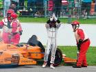 F1 champion Alonso swigs milk at Indy