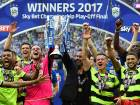 Goalkeeper Danny Ward (centre left) and head coach David Wagner (centre right) hold up the Championship Playoff trophy as Huddersfield's players celebrate winning the penalty shoot-out against Reading.