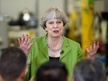 May depicted as running scared as lead slips