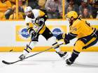 Pittsburgh Penguins defenceman Justin Schultz (left) passes the puck past Nashville Predators defenceman Roman Josi during the third period in game three of the Stanley Cup final.